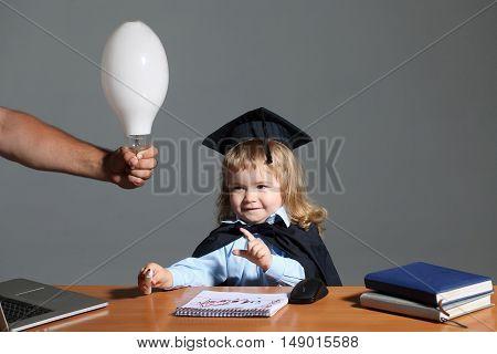 Little Boy At School Desk