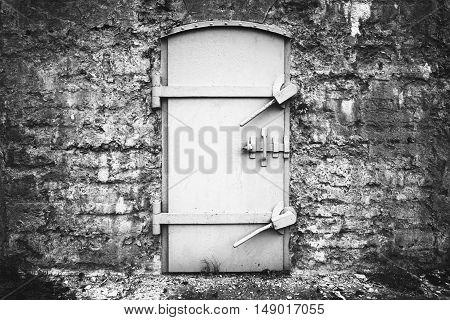 Locked Metal Door In Old Fortification Wall