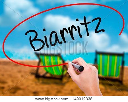 Man Hand Writing Biarritz  With Black Marker On Visual Screen