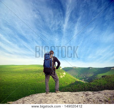 Man tourist in mountain. Nature and adventure composition.