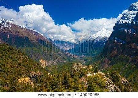 Landscape Snow Mountains Nature Viewpoint.Mountain Trekking Landscapes Background. Nobody photo.Asia Travel Horizontal picture. Sunlights White Clouds Blue Sky. Himalayas Hills
