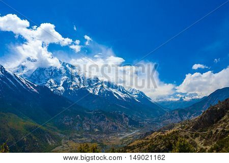 Landscape Snow Mountains Nature Viewpoint.Mountain Trekking Landscapes Background. Nobody photo.Asia Travel Horizontal image. Sunlights White Clouds Blue Sky. Himalayas Hills