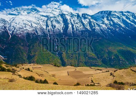 Landscape Snow Mountains Nature Viewpoint.Mountain Trekking Landscapes Background. Nobody photo.Asia Travel Horizontal picture. Sunlights White Clouds Blue Sky. Himalayas Hills Empty Fields