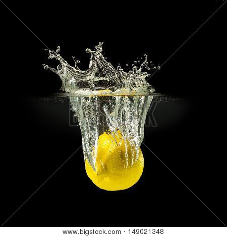 Fresh fruits falling in water with splash on black background.