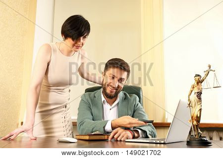 business partners discuss the news in the laptop