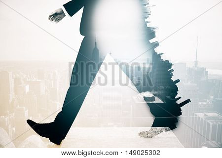 Legs of walking business man in suit on abstract city background. Double exposure