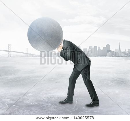 Man with concrete sphere instead of head on abstract city background. Burden concept