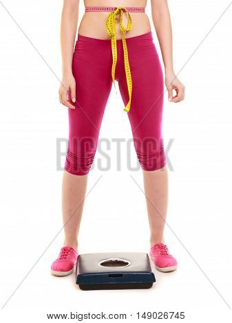 Woman With Tape Measure On Weighing Scale.