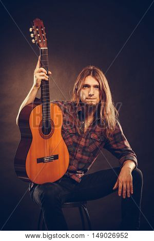 Guitarist Is Posing With Guitar.