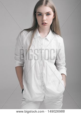 Beautiful young girl woman in white clothing and long hair
