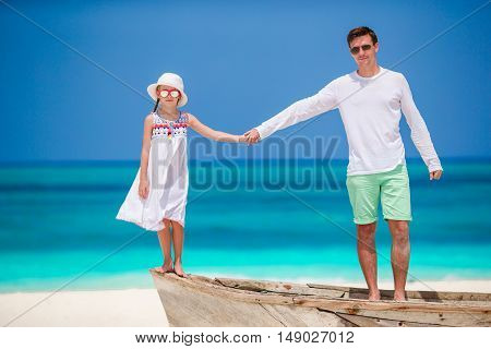 Beautiful father and her adorable little daughter at beach