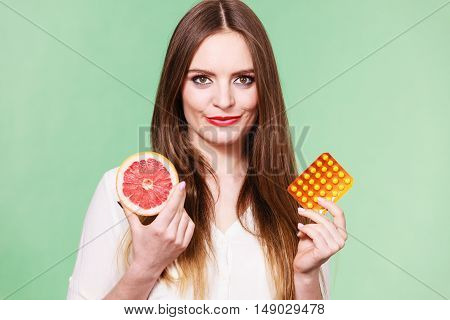 Woman Holds Grapefruit And Pills Blister Pack Vitamin C