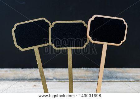 Wooden Mini Blackboard Labels Over Chalkboard Background