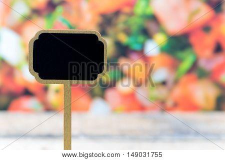 Wooden Mini Blackboard Label Over Vegetable Salad Background