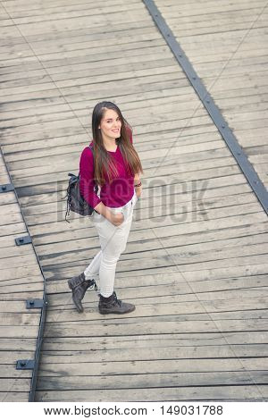Elevated View One Young Adult Girl Posing Casual Clothes Wood Floor Outdoors