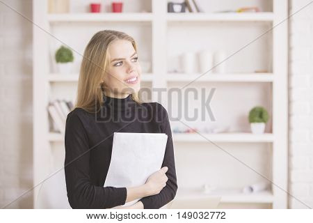 Businesswoman Daydreaming In Office