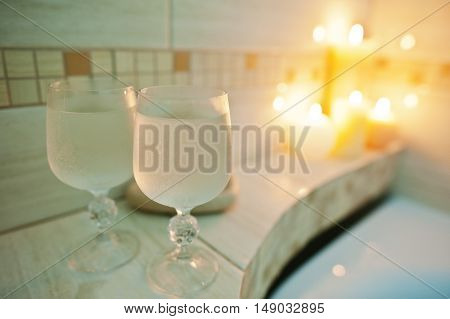 Two Wet Glasses Of Wine Background Burning Candles In Bathroom