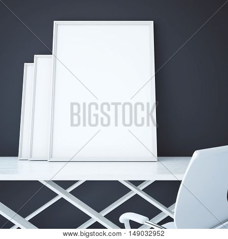 Three blank picture frames placed on white table on dark grey background. Mock up 3D Rendering