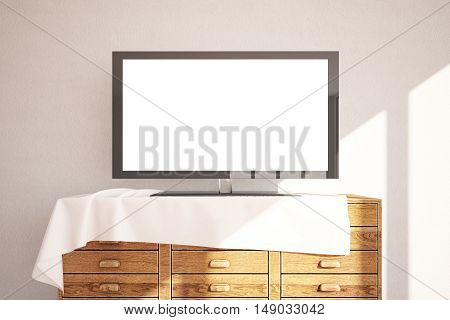 Front view of empty white TV screen placed on wooden cupboard with cloth on concrete wall background. Mock up 3D Rendering