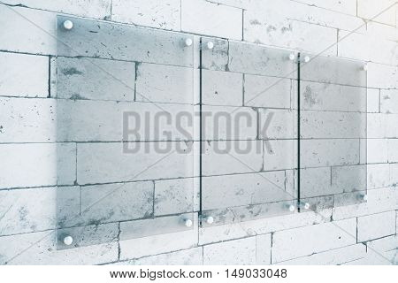 Side view of three empty glass plates on brick wall background. Mock up 3D Rendering