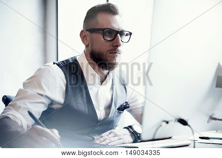 Portrait Bearded Stylish Young Man Wearing Glasses White Shirt Waistcoat Work Modern Loft Online Startup Project.Creative People Working Digital Tablet Drawing Desktop Computer Wood Table.Blurred