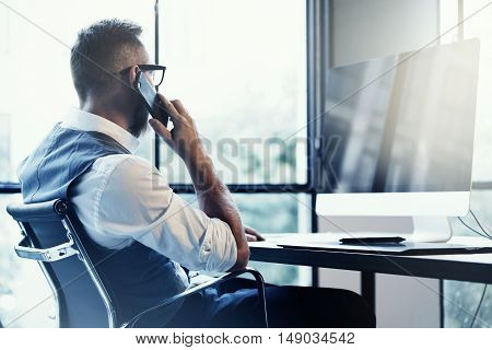 Stylish Bearded Young Man Wearing Glasses White Shirt Waistcoat Working Modern Loft Startup.Creative Guy Using Mobile Phone Call Partner.Person Drawing Digital Tablet Desktop Computer Workplace