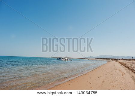 Small Ships On The Beach At Sea On Sunny Day