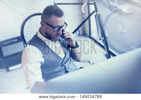 Bearded Businessman Analyzes Business Strategy Modern Workplace.Young Man Working Startup Desktop.Using Smartphone Making Consult Stock Trader.Guy Work Office Wearing White Shirt Waistcoat.Top View