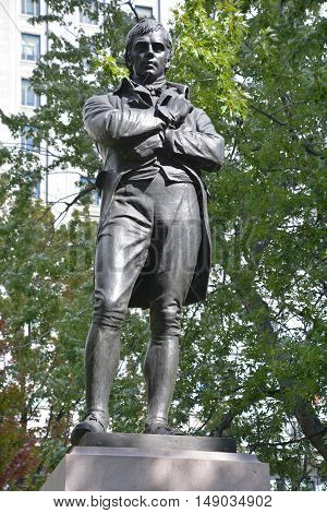 MONTREAL CANADA 09 23 2016: The memorial to the Scottish poet Robert Burns, a tribute to Montreal Scottish industrialists and financiers, represents the socially conscious and refined romantic ideal