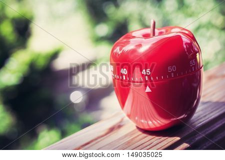 45 Minute Kitchen Egg Timer In Apple Shape Standing On A Handrail