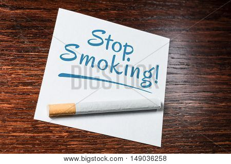 Stop Smoking Reminder With Cigarette On Wooden Shelf