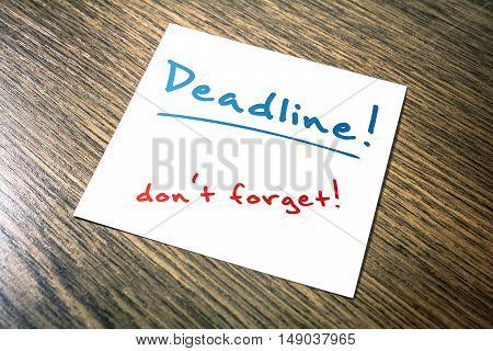 Deadline Reminder On Paper Lying On Wooden Cupboard