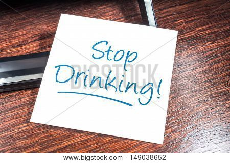 Stop Drinking Reminder On Paper On Wooden Cupboard