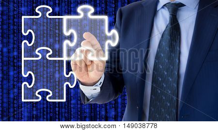 Businessman in a blue suit clicking one of three jigsaw pieces on a screen with a blue digital background