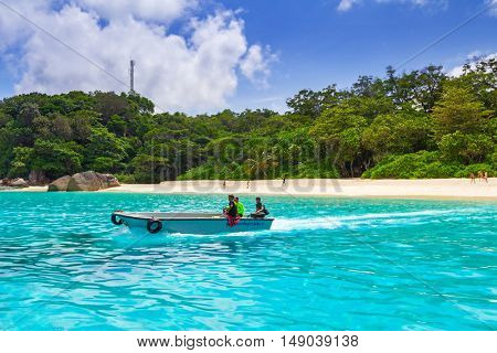 SIMILAN ISLANDS, THAILAND - NOV 6, 2012: An unidentified man navigate on his boat to transport tourist over the Similan Islands National Park. Similans island are a big tourist attraction in Thailand.