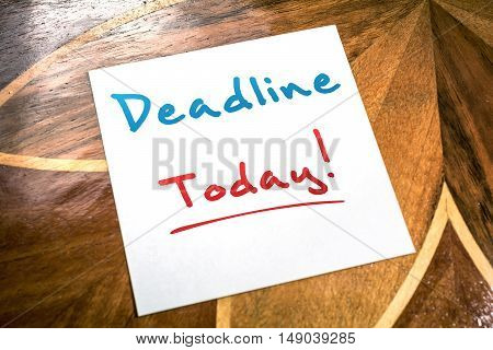 Deadline Sticky Note On Paper For Today Lying On Wooden Table