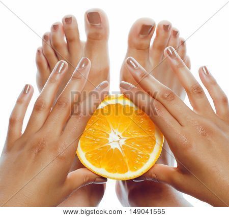 manicure pedicure on afro-american tan skin hands holding orange, healthcare spa concept