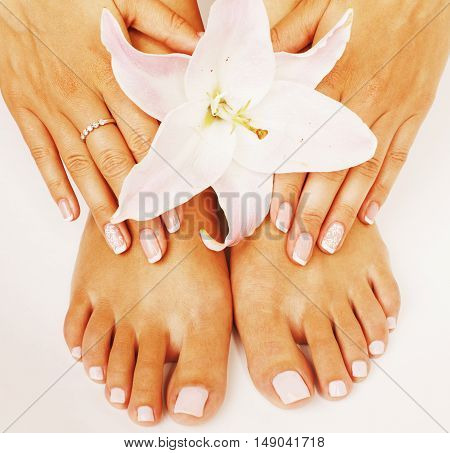 manicure pedicure with flower lily close up isolated on white perfect shape hands, spa concept
