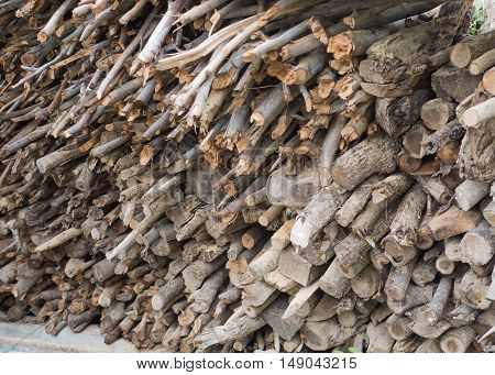 Stacked logs wood for fireplace in construction