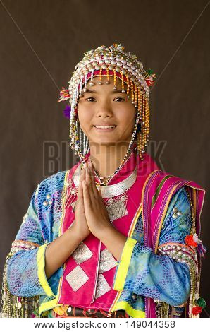 CHIANGMAI,THAILAND - NOVEMBER 30, 2014: Unidentified Palaung girl in the Palaung traditional costume poses for the camera. Palaung people is a minority ethnic group living in northern Thailand