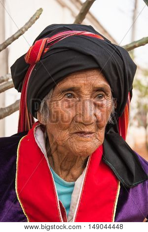 CHIANGMAI,THAILAND - FEBRUARY 20, 2016: Unidentified Palaung old woman in the Palaung traditional costume poses for the camera. Palaung people is a minority ethnic group living in northern Thailand.