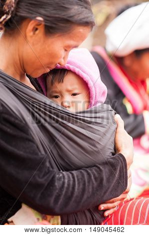 CHIANGMAI,THAILAND - JANUARY 11, 2015: Unidentified Palaung mother and child pose for the camera. Palaung people is a minority ethnic group living in northern Thailand