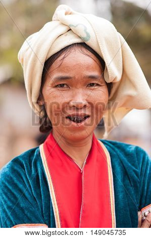 CHIANGMAI,THAILAND - JANUARY 11, 2015: Unidentified Palaung woman in the Palaung traditional costume poses for the camera. Palaung people is a minority ethnic group living in northern Thailand