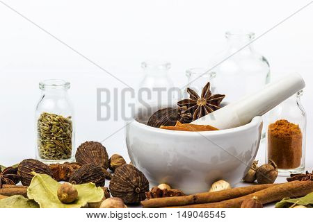 A photo of Mortar Grinder Herb and herbal medicine on white background Selective focus Soft focus