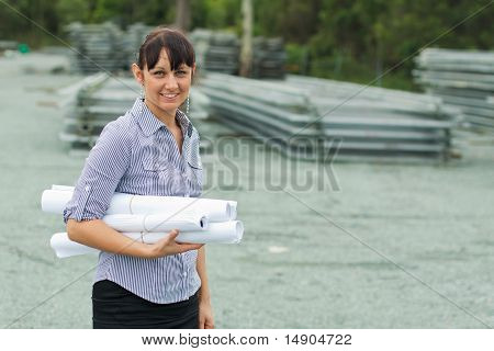Young Engineer Woman Supervising The Yard