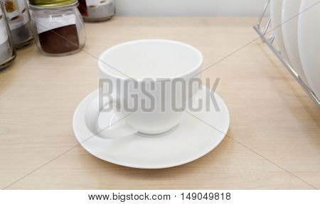 empty coffee cup or tea cup on the wooden table
