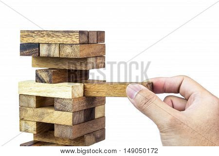 A photo of man playing jenga A risks in business concept Selective focus Soft focus