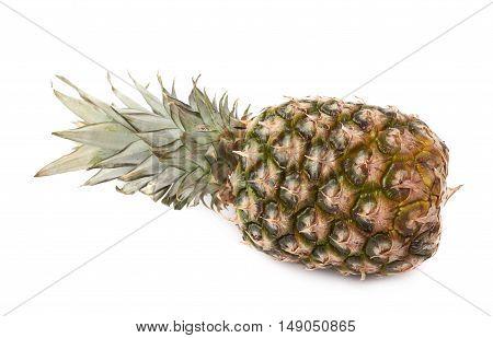Whole raw fresh pineapple isolated over white background