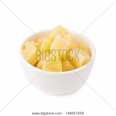 Pile of canned pineapple  in bowl over isolated white background