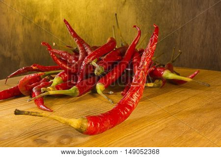 Red chili peppers on a wooden background